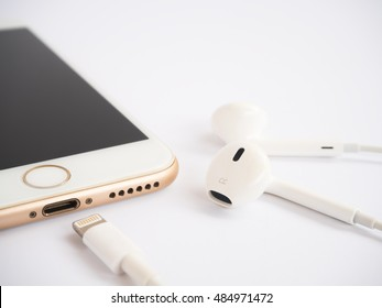 CHIANGRAI, THAILAND -SEPTEMBER 9, 2016: Close-up image of new Apple iPhone7 mockup and new Apple EarPods mockup on white background.