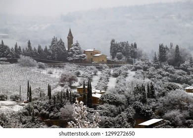 The Chianti landscape in the Tuscan hills after a winter snowfall. Chianti, Tuscany, Italy