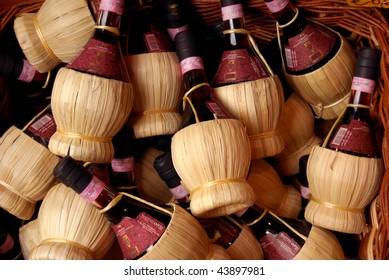 Chianti wine in raffia wrapped bottles