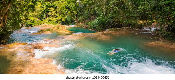 CHIAPAS, MEXICO - NOVEMBER 30: Unidentified woman swimming in natural pools of Agua Azul on November 30, 2016 near Palenque in Chiapas, Mexico.