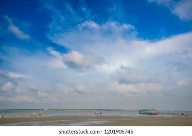 Chiayi , Taiwan - Sep 22, 2018: Ocean exploration - boat to Dongshih Waisanding Sand Bar, Raising oysters, oyster farming , catching fish, nice food at boat. Chiayi County, Taiwan