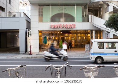 Chiba, japan, 04/02/2019 , Chiba Caffe' Veloce. Franchising coffee shops in Japan, with vehicles passing fast in front of it.