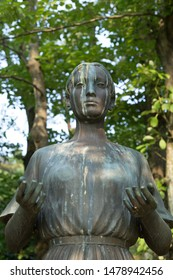 """chiba, japan, 08/01/2019 , Statue representing """"mother Earth"""" with compassionate open hands in Chiba kouen park, near the Chiba Kengokoku shrine."""