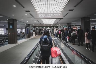 Chiba, Japan - April 15, 2017: Passengers walking in the departure terminal of Narita International Airport with belonging on moving walkway