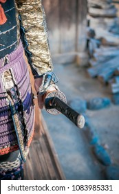Chiba, JAPAN - Asian Man in Samurai armor suit and warlord hat holding Japanese Katana sword, Close up