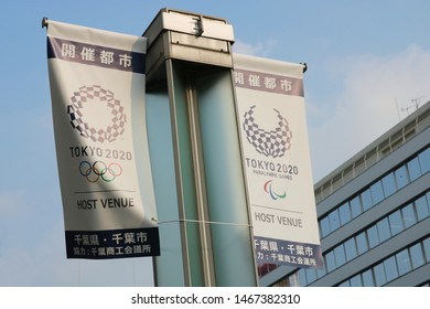 CHIBA, JAPAN - August, 2019: Banners promoting the Tokyo Olympics & Paralympics on a modern streetlight. Some Olympics events, fencing, surfing etc., will be held in Chiba Prefecture.