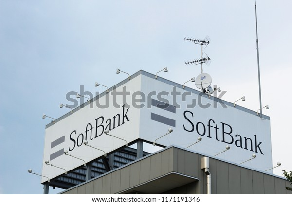 CHIBA, JAPAN - August 29, 2018: Advertsing on the roof of a  branch of the Japanese telecommunications company Softbank in Chiba City's Inage area.