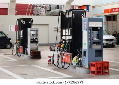 CHIBA, JAPAN - August 7, 2020: Fuel dispensers on the forecourt of an Eneos gas station in Ichikawa City in Chiba Prefecture.