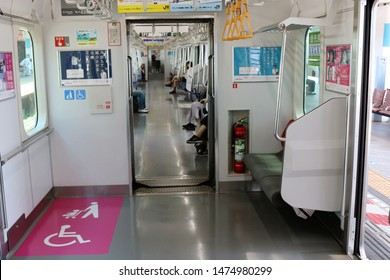 CHIBA, JAPAN - August 9, 2019: Interior of a Tokyo subway train including area for pushchairs / wheelchair users. Train is at a Nishi Funabashi station, a terminal station on Tokyo Metro's Tozai Line.