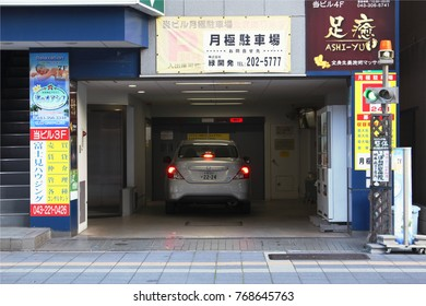 CHIBA, JAPAN - December 2, 2017: A car enters the loading level of a parking tower in central Chiba City.