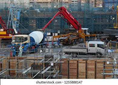 CHIBA, JAPAN - December 4, 2018: View of a multi-purpose building's (shopping centre, apartments etc.) construction site in Chiba City including a cement mixer truck & concrete pump.