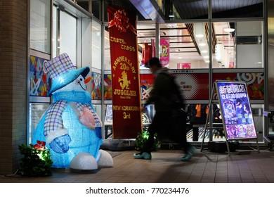 CHIBA, JAPAN - December 6, 2017: A customer walks past a festive illuminated snowman to enter a pachinko parlor in Chiba City.