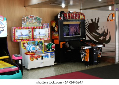 CHIBA, JAPAN - February 22, 2019: A pair of video games machines in a Chiba City bowling alley.