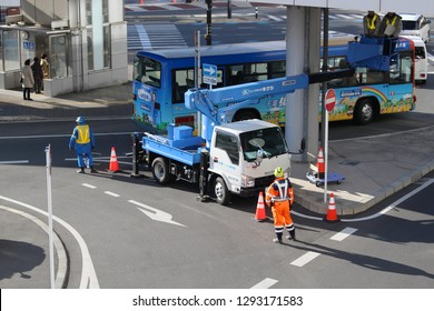 CHIBA, JAPAN - January 22, 2019: A footbridge linked to Chiba Station being inspected by workers using a crane truck.