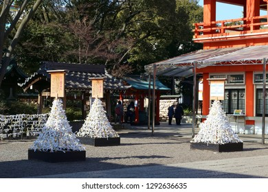 CHIBA, JAPAN - January 23, 2019: View of the part of Chiba City's Chiba Shrine with a 'trees' of folded O-mikuji fortune papers in the foreground.