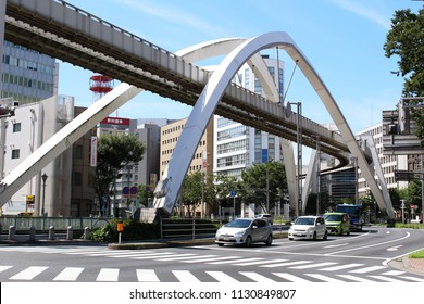 CHIBA, JAPAN - July 10, 2018: View of traffic below a section of Chiba City Urban Monorail tracks which are supported by large arches.