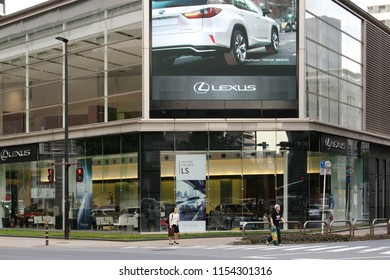 CHIBA, JAPAN - July 12, 2018: View of a large Toyota Lexus showroom in Chiba City which has a giant screen which shows adverts and displays public information.