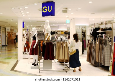 CHIBA, JAPAN - July 19, 2018: A shopper in the women's clothes in a GU store in Funabashi's Lalaport shopping mall. GU is owned by Fast Retailing which also owns Uniqlo.