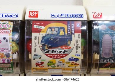 CHIBA, JAPAN - July 21st, 2017: A close-up of a so-called gashapon toy vending machines (toys come in a plastic capsule) in a shopping mall. This one has models of old three-wheeled vehicles.