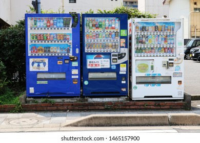 CHIBA, JAPAN - July 30, 2019: A row of three vending machines at the front of a car park in Chiba City Street.