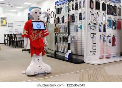 CHIBA, JAPAN - June 6, 2018: A Softbank Pepper robot on customer service duty at the front of a Softbank. It's wearing a Softbank Hawks uniform, a baseball team sponsored by the company.
