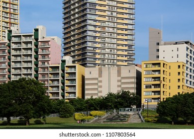 CHIBA, JAPAN - June 7, 2018: View of Makuhari Baytown with various colorful modern mid-rise apartment blocks with high-rise blocks in the background.