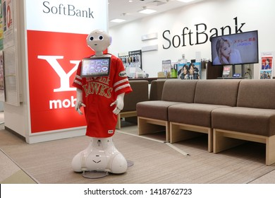 CHIBA, JAPAN - June 7, 2019: A Softbank Pepper robot on customer service at the front of a Softbank store in Chiba. It's wearing a Softbank Hawks uniform, a baseball team sponsored by the company.