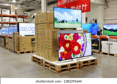 CHIBA, JAPAN - March 20, 2019: Giant 8K Sharp Aquos televisions on display in a Japanese branch of the American membership warehouse club Costco.