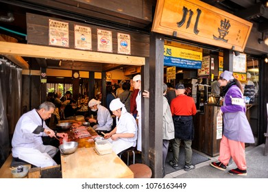 CHIBA JAPAN - MARCH 26, 2018 : Naritasan Omotesando road, Unidentified chef is cutting eel, which is a very popular dish for here. Popular tourists eat here until they have to queue up ahead.
