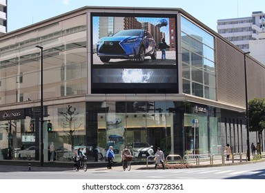 CHIBA, JAPAN - March 8th, 2017: A Toyota Lexus showroom with a giant screen in Chiba City.