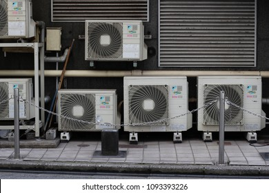 CHIBA, JAPAN - May 17, 2018: Air conditioner condenser units at street level on a multi-story building in downtown Chiba City. They are connected to various bars and clubs housed inside.