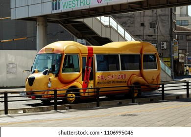 CHIBA, JAPAN - May 22, 2018: A bus belonging to a private kindergarten with a cute dog face in Chiba City. Buses like this one carry children to and from kindergarten.