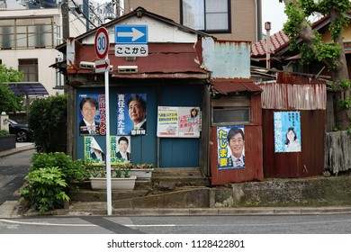 CHIBA, JAPAN - May 3, 2018: An old and apparently abandoned buidling covered with political party posters from a variety of parties in the Midoridai area of Chiba City.