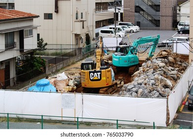 CHIBA, JAPAN - November 2, 2017: On a site surrounded by screens, workers complete demolition work on a four-story apartment building in Chiba City.