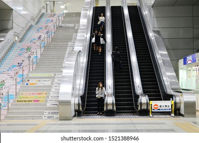 CHIBA, JAPAN - September 27, 2019: Long escalators and flight of stairs in Cniba Monorail Station. Some motion blur.