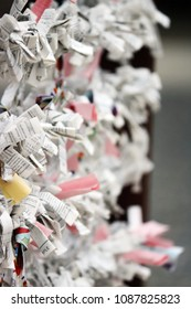 Chiba, JP - MAY 6, 2018: Many white fortune-telling papers are stripped near Narita-san shrine.