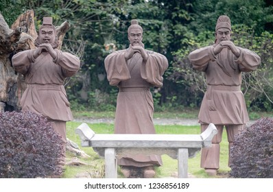 CHIBI, HUBEI/ CHINA - OCT 25 2018: Statues of Guan Yu, Liu Bei and Zhang Fei (Oath of the Peach Garden) in Peach garden. At the Three kingdom Chibi Battle field. Chibi, China