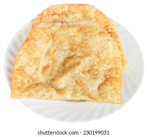 chiburekki pie on white plate isolated on white background