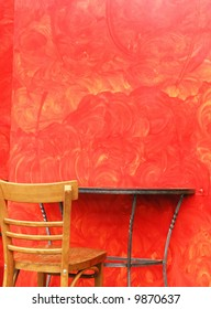 Chic Cafe Table & Chair Against Red Background