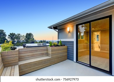 Chic Master deck with custom built cedar bench and planter boxes is overlooking Lake Washington. Northwest, USA