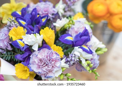 A chic multi-colored bouquet of flowering iris, cloves and hyacinth. Festive design of the windows of the floral store