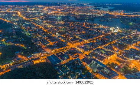 Chic panoramic aerial view of the night city of Kiev, namely the Podol with night illumination, Ukraine