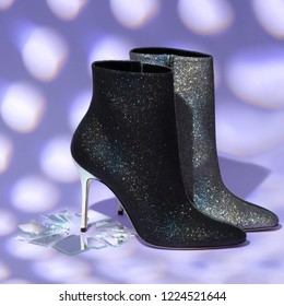 Chic sparkling low boots black and silver with sparkles on high heels, stand on a broken mirror on a lilac soft background, for designers, a place for signature, empty, mock-up