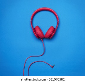 Chic & Stylish Overear Bluetooth Red Headphones, front view , isolated on blue background