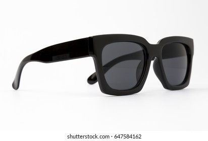 Chic sunglasses with black plastic frame isolated on white background, front view.