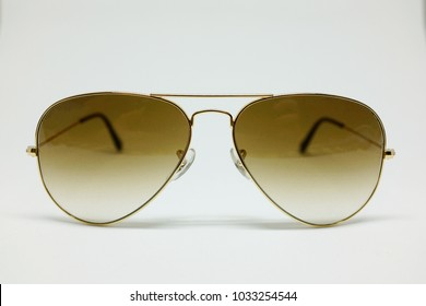 Chic sunglasses with brown and gold steal frame isolated on white background, front view