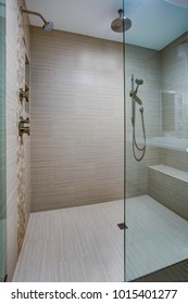 Chic Walk-in shower with built-in bench and beige subway tiled interior.