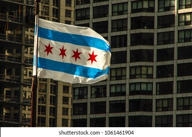 Chicago, IL—March 28, 2018 red white and blue Chicago city flag flies in the wind in downtown