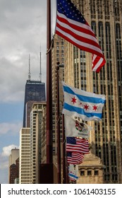 Chicago, IL—March 31, 2018 line of flags blowing in the wind in front of downtown skyline