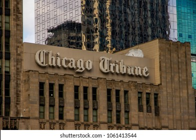 Chicago, IL—March 31, 2018 Chicago Tribune newspaper sign hangs off the side of building in downtown skyline